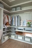 Wooden wardrobe with set of clothes. Modern closet with clothes, interior design decoration concept stock image