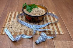 Wooden ware of folk art with pearl barley and centimeter. The Russian Khokhloma Stock Photo