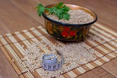 Wooden ware of folk art with pearl barley and centimeter. The Russian Khokhloma Royalty Free Stock Image