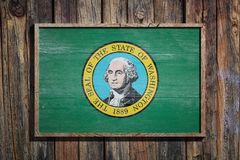 Wooden Washington flag. 3d rendering of a Washington State USA flag on a wooden frame and a wood wall Royalty Free Stock Images