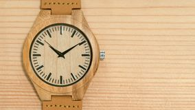 Wooden watch close-up. Wooden watch on wooden background stock video
