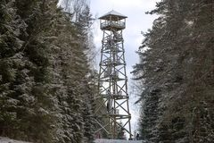 Wooden watch tower for tourists to observe the surrounding landscape in forest. Wooden watch tower for tourists to observe the surrounding landscape in winter Stock Photo