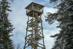 Wooden watch tower for tourists to observe the surrounding landscape in forest. Wooden watch tower for tourists to observe the surrounding landscape in winter Stock Image