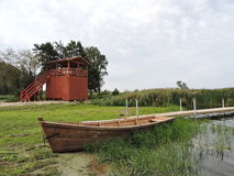 Wooden watchtower, bridge and boat Royalty Free Stock Image