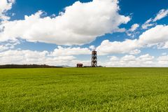 Wooden watchtower in the fields. Lookout tower Radosinka with many visitors located on the top of a hill under blue sky with beautiful clouds Stock Photography