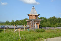 Wooden watchtower and monastic cemetery in the territory of the  Sacred and Troitsk Trifonov-Pechengsky man's monastery Royalty Free Stock Photo
