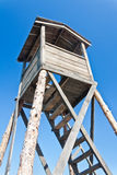 Wooden watchtower in prison camp. Over blue sky Royalty Free Stock Photos