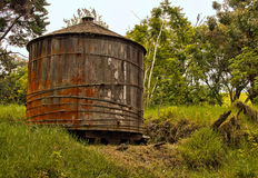 Wooden water tank in rural Hawaiian backcountry. An old wooden water cistern tank rests in a lush hill in the highland backcountry on the slopes of Mount Stock Images