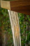 Wooden Water Feature Garden. Wood Garden Fountain At Luxury Resort Stock Photo