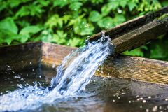 Wooden Water Fountain stock images