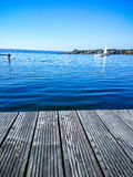Wooden water jetty at lake. As background Royalty Free Stock Photography