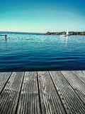 Wooden water jetty at lake Stock Photo