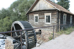 Wooden water mill. Old wooden water mill. on river Stock Image