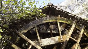 Wooden water mill wheel spinning.  stock video