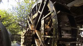 Wooden water mill wheel spinning.  stock video footage