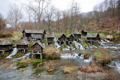 Wooden water mills built on a fast floting river Royalty Free Stock Photography