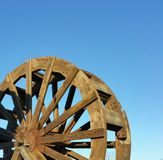 Wooden Water Paddle Wheel - Blue Sky Stock Photo
