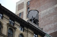A wooden water storage tank on a New York City rooftop. On an overcast winter day Royalty Free Stock Photography
