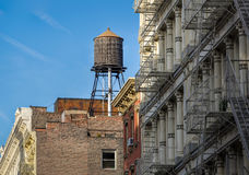 Wooden water tank and cast iron facades, Soho, New York Royalty Free Stock Photos