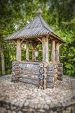 Wooden water well. Old wooden water well closeup. Tilt shift effect Royalty Free Stock Photo