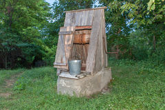 Wooden water well. In rural area Stock Image
