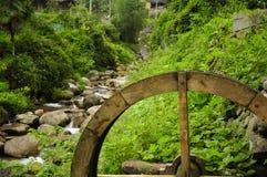 Wooden water wheel Chinese village Stock Photos