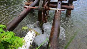Wooden water wheel turning under power, water mill on a Pond. Wooden water wheel turning under power, water mill on a Lake stock video footage