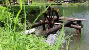 Wooden water wheel turning under power, water mill on a Pond. Wooden water wheel turning under power, water mill on a Lake stock video