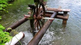 Wooden water wheel turning under power, water mill on a Pond. Wooden water wheel turning under power, water mill on a Lake stock footage