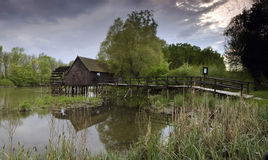 Wooden Watermill. Ancient mill in the beautiful green countryside Stock Photo