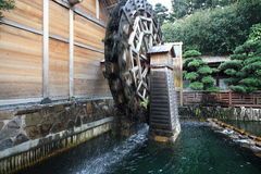 Wooden waterwheel. A wooden waterwheel is rotating Royalty Free Stock Images
