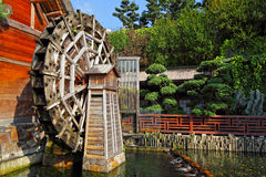 Wooden waterwheel Stock Photo