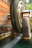 Wooden waterwheel is rotating Royalty Free Stock Photography