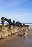 Wooden wave breakers at seaside Stock Photos
