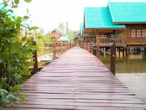 Wooden way with home stay Royalty Free Stock Images