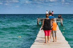 Wooden way in the sea stock image