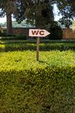 Wooden WC Sign on One Hedge stock photo