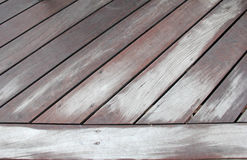Wooden weathered walkway at an diagonal angle Stock Photo
