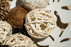 Wooden weave decorative balls in white decorative dish. On wood table Royalty Free Stock Image