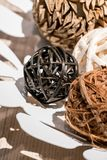 Wooden weave decorative balls in white decorative dish. On wood table Stock Images