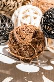 Wooden weave decorative balls in white decorative dish. On wood table Stock Photography