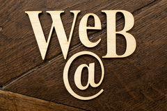 Wooden Web word. Wooden alphabet letters on old wooden surface Royalty Free Stock Image