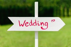 Wooden wedding arrow sign Stock Photo