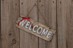 Wooden welcome sign with ribbon Royalty Free Stock Photos