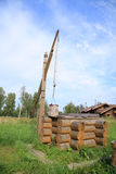 Wooden well. Old wooden well a crane Stock Photography