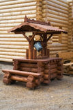 Wooden well with a bucket. Wooden well with a steel bucket royalty free stock images