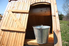 Wooden well with a bucket Royalty Free Stock Photography