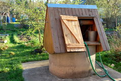 Wooden well at dacha. The well at dacha in Moscow area replaces a water supply system Royalty Free Stock Image