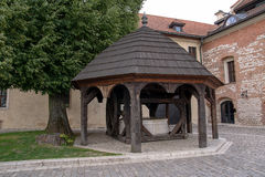 Wooden well in Tyniec (Poland). Wooden well in Benedictine Abbey in Tyniec (Poland Stock Image