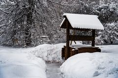 Wooden Well winter snow covered royalty free stock photography